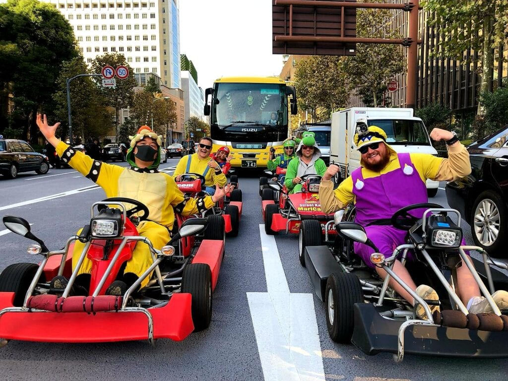 Driving mario kart on the open streets of Tokyo.