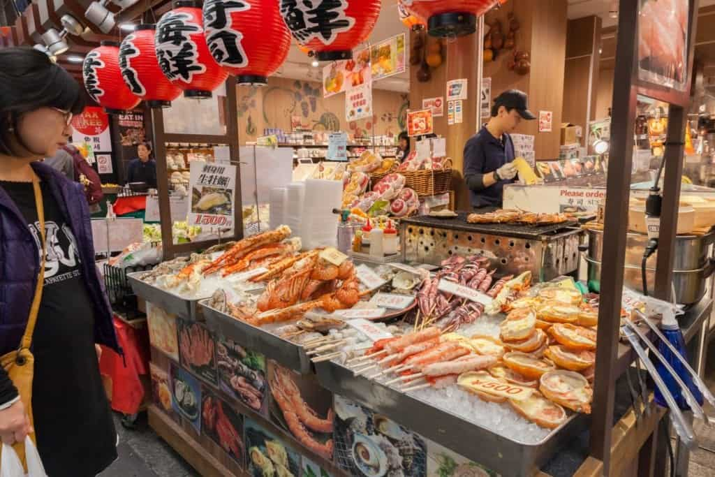 Seafood being sold over disk at Kuromon market, Osaka.