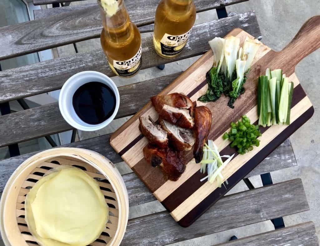 Friends eating Peking duck.