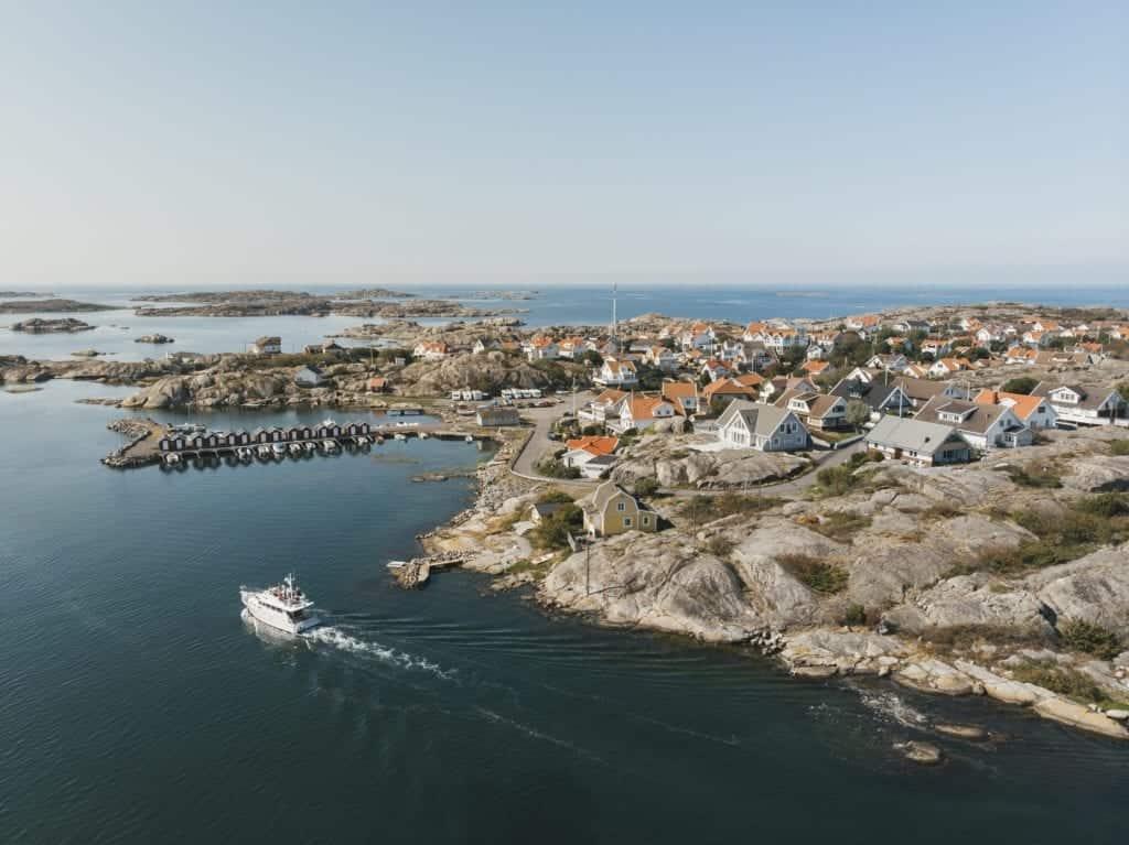 Boat sailing between cliffs in Södra Skärgården in Göteborgs Norra Skärgård.