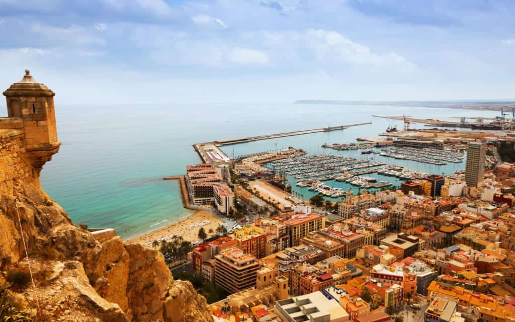 Top view of Port in Alicante with docked yachts from castle. Spain