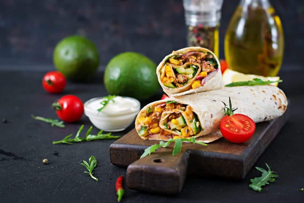 Burrito prepared with chicken wrap.
