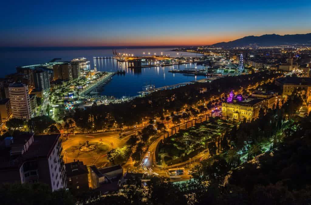 Aerial view over Málaga at night.