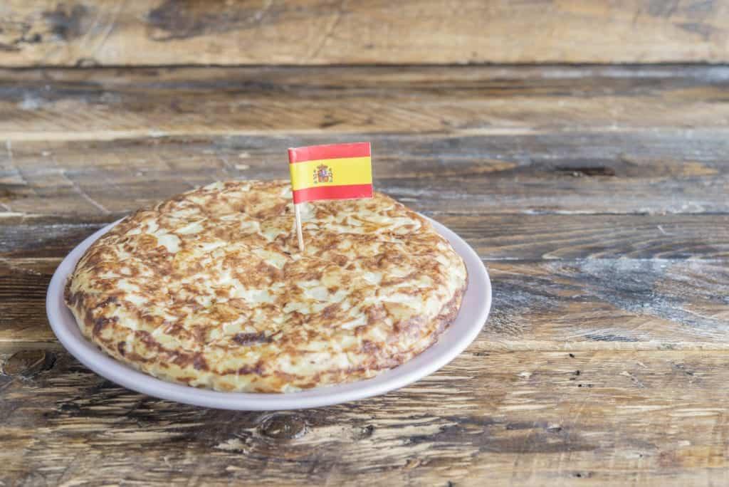 TORTILLA DE PATATAS at a local shop with flag in food.